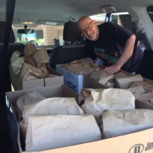 Bryan packs lunches for Casa Maria clients